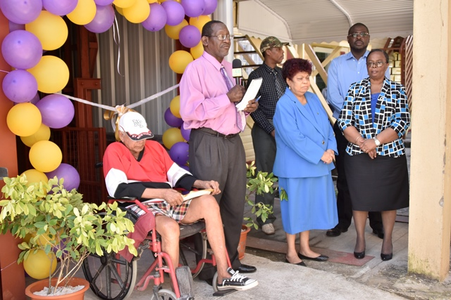From left, a resident of the Palms, Mr.Michael Persaud, Probation and Social Services Officer, Mr. Aggrey Azore, Minister of Social Protection, Ms. Amna Ally, Director of Social Services, Mr Wentworth Tanner and Permanent Secretary Ms. Lorene Baird at the commissioning ceremony.
