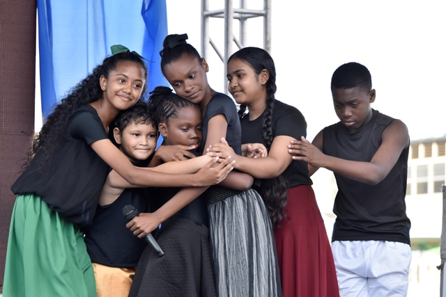 A group of children perform a skit at the Child Protection Week rally.