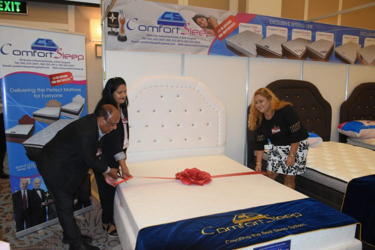 Managing Director of Comfort Sleep, Dennis Charran cuts the ribbon to officially launch the new line of comfort sleep mattress