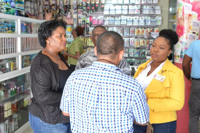 CCAC officers interact with a supplier in Georgetown