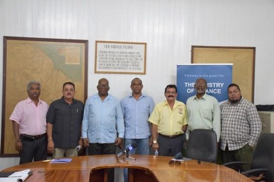 Minister of Finance Winston Jordan (centre) with GGDMA Executives.