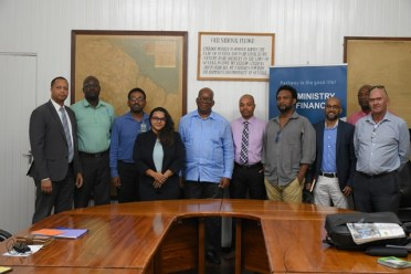 Minister of Finance Winston Jordan (centre with blue shirtjack) with young business entrepreneurs after the 5th day of Budget 2019 consultations.