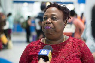 Arriving passenger, Doreen Jonas is an overseas-based Guyanese returning home for vacation
