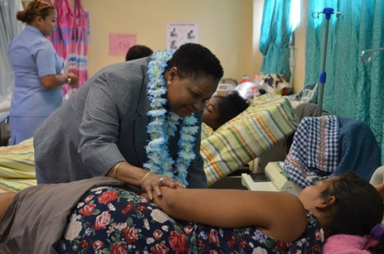 During the tour around the Linden Hospital Complex, Minister Lawrence took the opportunity to reach out to a patient in the Maternity ward.