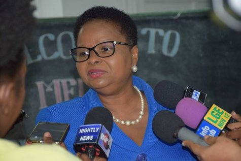 Minister of Public Health, Volda Lawrence responding to media's questions.