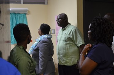 The health management committee and Minister Lawrence examines nurses' quarters in the Linden Hospital Complex.