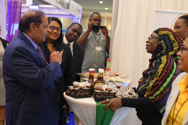 Chief Executive Officer (CEO) of SS Natural Fruit Flavour, Sandra Craig, engages with Prime Minister Moses Nagamootoo.
