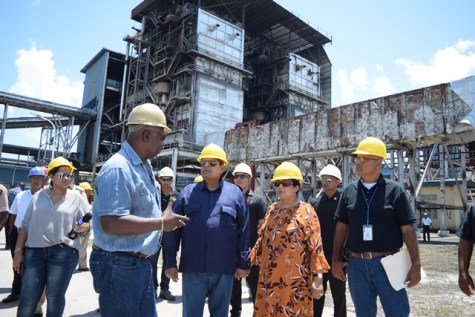 Skeldon Estate Operations and Maintenance Manager, John Loncke explaining to Prime Minister Moses Nagamootoo some of procedures of the power plant.