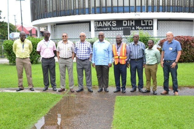 Minister of Finance Winston Jordan (centre) with Banks DIH Executives.