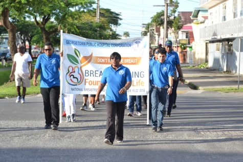 Minister within the Ministry of Public Health, Dr. Karen Cummings leads the breastfeeding walk activity and other health sector stakeholders.