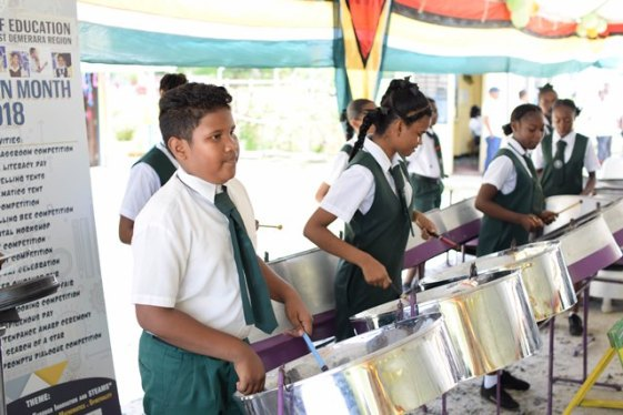 Students of the West Demerara Secondary School performing a rendition on the steel band.