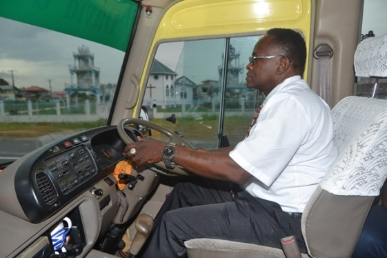 Driver of the David G school bus, Robert Williams taking the students to school.