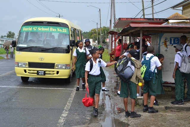 Students of Patentia Secondary being dropped off to school by the David G school bus.