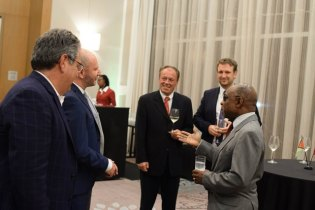 Foreign Affairs Minister, Carl Greenidge shares a light moment with members of the VAMED team in Guyana.