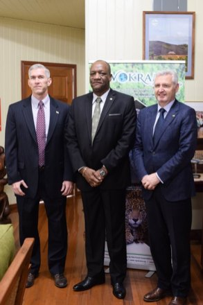 Minister of State, Joseph Harmon, flanked on the left by Country Manager, ExxonMobil, Rod Henson and on the right by Executive Vice President, Esso Exploration, Mike Cousins.