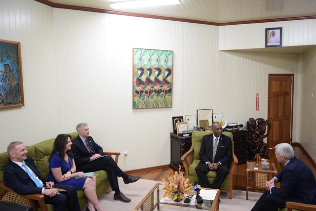 Minister of State Joseph Harmon in discussions with Executive Vice President, Esso Exploration, Mike Cousins and officials of ExxonMobil.