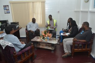 GPL, CEO, Albert Gordon discussing with GPL's officials on the situation at Anna Regina Power station.