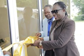Minister of Education, Hon. Nicolette Henry cutting the ceremonial ribbon to officially open the new building