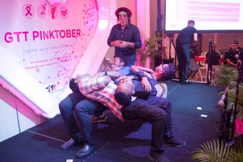 Members from the Suraez Circus performing at the launch of Pinktober.