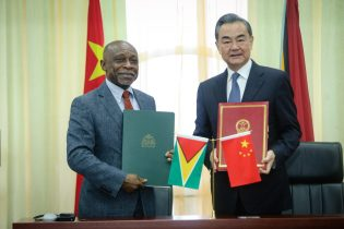 Minister Greenidge and Minister Yi following the signing of agreements.