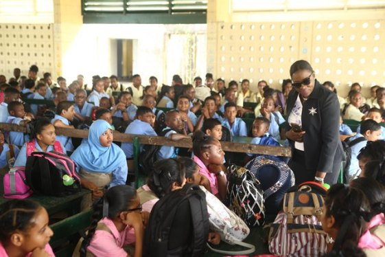 Minister of Education, Nicolette Henry interacting with students at the New Amsterdam Multilateral High School.