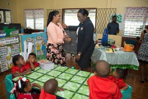 Minister of Education, Nicolette Henry and a teacher at Edingburg Nursery School.