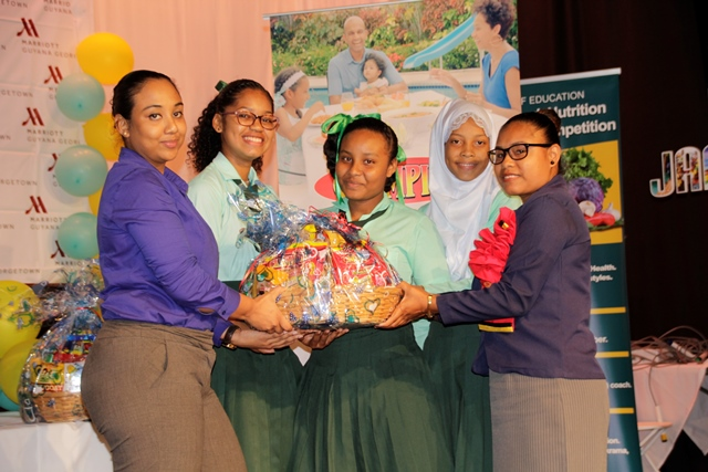 The students of Port Kaituma Secondary School receiving their prizes from Beharry Group of Companies representative.