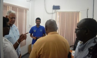 Minister Holder and other officials while touring the facilities.