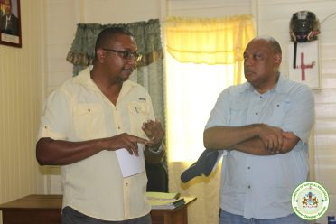 Minister Trotman listens to the concern of Kwakwani Forest Station staff