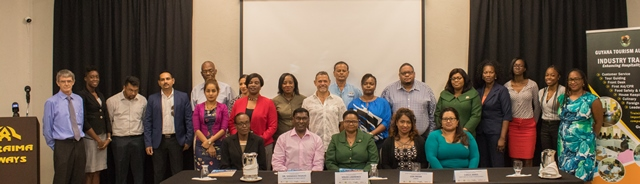 Seated at front row from left Ms Abbigail Liverpool, Dr Shamdeo Persaud, Minister Volda Lawrence, Dr Lisa Indar and Ms Carla James with some of the participants standing at the back.