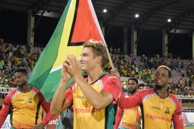 The Guyana Amazon Warriors team celebrating their victory with the crowd before heading to the finals.