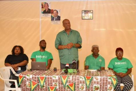 (Left to right) – Port Kaituma Councillor, Jocelyn Abrams, Director of Sports, Christopher Jones, Minister of State, Joseph Harmon addressing the residents, Member of Parliament, Richard Allen and another Councillor.