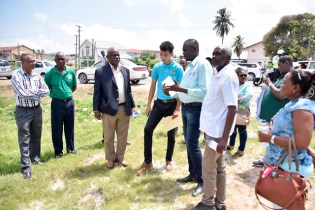 Minister of Citizenship, Mr. Winston Felix discusses the construction of the building and parking facility for the passport office, with engineers and technical officers.