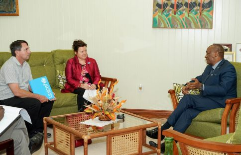 Minister of State, Mr. Joseph Harmon (right) makes a point to United Nations Children's Fund (UNICEF) Representative to Guyana, Ms. Sylvie Fouet and United Nations Children's Fund, Emergency Specialist, Mr. Ian Jones, during a discussion on the Climate Landscape Analysis for Children today