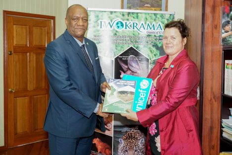 Minister of State, Mr. Joseph Harmon receives theClimate Landscape Analysis for Childrenreport from United Nations Children's Fund (UNICEF) Representative to Guyana, Ms. Sylvie Fouet