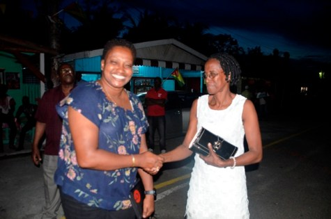 Minister Annette Ferguson greets residents of New Amsterdam.