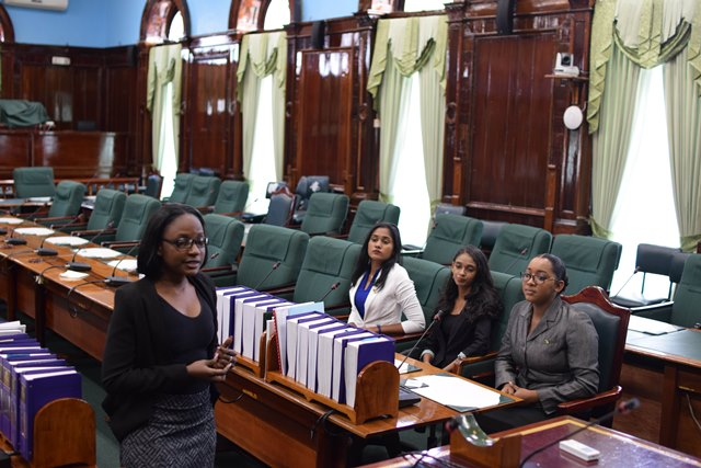 Prime Minister for a day - Delecia George, President for a day - Renuka Persaud, and Canadian High Commissioner for a day - Sara Mohan while at parliament.