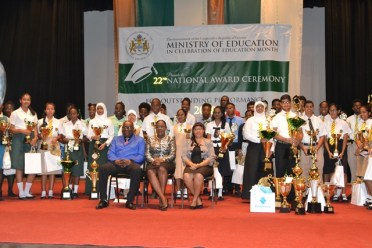 (left to right) Chief Education Officer Marcel Hutson, Minister of Education Dr. Nicolette Henry and Permanent Secretary to the Ministry of Education (ag) Adele Clarke along with the with top students.