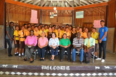 First Lady, Mrs. Sandra Granger (seated third left) takes a photograph with students of the Annai Secondary School, administrators of the Upper Takutu-Upper Essequibo Region and facilitators of the STEM/ Robotics workshop
