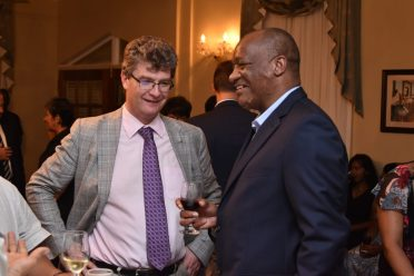 British High Commissioner to Guyana, Mr. Greg Quinn shares a light moment with Minister of State, Mr. Joseph Harmon during the welcome reception held at the Cara Lodge