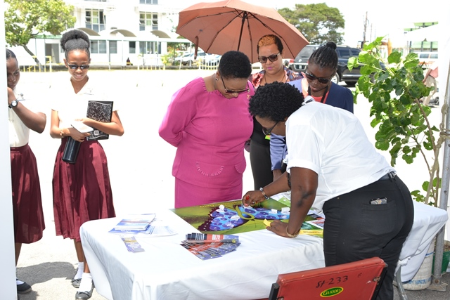 Minister of Public Health, Volda Lawrence visiting one of the health booths.