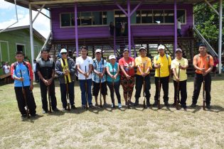 Residents from communities in Region Seven (Cuyuni-Mazaruni) pose with their newly licenced firearms