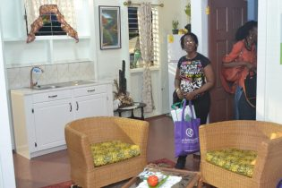Patrons to the Green Guyana Expo inspecting the CHPA's model home