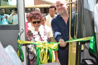 Minister of Social Protection, Amna Ally and Casino Manager at Princess Ramada Hotel, Eray Kanmaz cut the ribbon to commission the David 'G' School Bus.