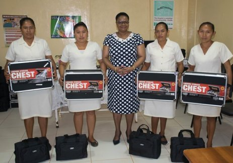 [In the photo, centre] Minister of Public Health, Volda Lawrence and the CHWs who collected their tool kits on Friday.