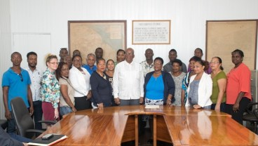 Minister of Finance, Winston Jordan [centre] with mining syndicates' representatives after the signing of the concessional agreement for small and medium scale miners.