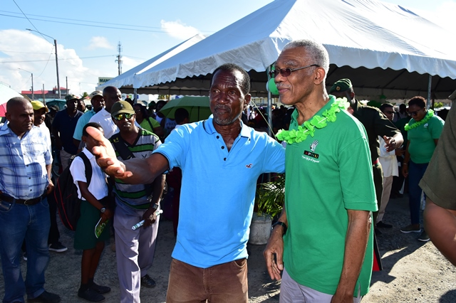 A resident of Anna Region makes a point to President David Granger at the conclusion of a community meeting held at the Anna Regina car park.