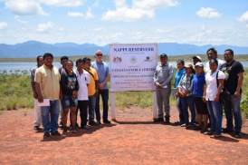 Minister of Indigenous Peoples' Affairs, Sydney Allicock and Chief Executive Officer (CEO) of Cataleya Energy Limited, Michael Cawood along with the Toshao Guy Fredericks and councillors of the Nappi Village at the Reservoir.