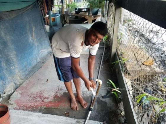 Rajpaul Narine washing his feet.
