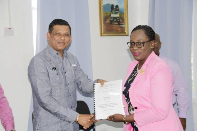 Minister of Education, Hon. Nicolette Henry and Managing Director of B.K International Inc., Mr. Brian Tiwarie displaying the signed contract for the construction of the Good Hope Secondary School.
